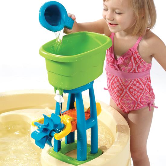 toddler playing with catapult of water table