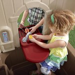 ringing the doorbell of the compact playhouse toy
