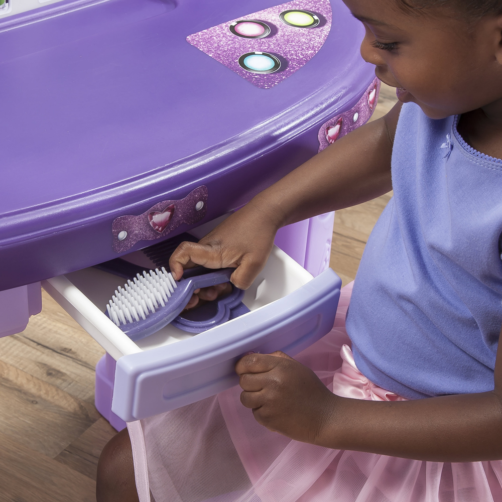 Opening drawer of pretend play vanity